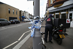 © Licensed to London News Pictures. 05/05/2019. London, UK. A leftover of police tape on Leyton High Road in East London. According to the locals, three men believed to be 23, 28 and 30, suffered gunshot wounds in the shooting just before 9 pm on Saturday 4 May 2019 outside Al Jaziira cafe opposite The Lion and Key Hotel. A 30 year old victim is in critical condition. Photo credit: Dinendra Haria/LNP