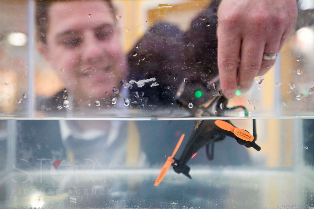 """UNITED KINGDOM, London: 25 January 2016 Joshua Farleigh, managing director of Flying Gadgets shows off the """"Water- X"""" drone, a drone which can operate under water on display at The Toy Fair at Olympia, the UK'S only dedicated game and hobby event with more than 260 toy and gaming brands. The fair runs until tomorrow. Rick Findler / Story Picture Agency"""