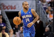 Dec. 09, 2012; Phoenix, AZ, USA; Orlando Magic guard Jameer Nelson (14) dribbles the ball up the court during the game against the Phoenix Suns in the first half at US Airways Center. Mandatory Credit: Jennifer Stewart-USA TODAY Sports.