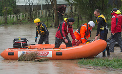Emergency services near Burnbrae Street, Beckenham after flooding from the Heathcote River, Christchurch, New Zealand, Saturday, July 22, 2017. Credit:  SNPA / David Alexander -NO ARCHIVING-
