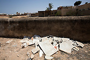 Broken tombstones litter  the outer perimeter of the cemetery behind the Great Synagogue of the tiny Tunisian Jewish community on the island of Djerba on May 27,2016. Vandals  did not break the gravestones but the graves were  exhumed and sent to Israel for reburial . (Photo by Heidi Levine).