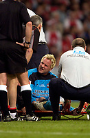 Photo. Richard Lane<br />Arsenal v Southampton. FA Cup Final. 17/05/2003.<br />Antti Niemi recieves treatment and is taken off