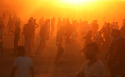 November 2, 2018 - Gaza, Palestinian Territories, Palestine - Palestinians run from tear gas fired by Israeli troops during a protest calling for lifting the Israeli blockade on Gaza, at the Israel-Gaza border fence in Gaza. (Credit Image: © Majdi Fathi/NurPhoto via ZUMA Press)