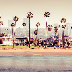 Newport Beach skyline retro panorama photo. Picture includes Newport Beach office buildings, Balboa Peninsula beach, Peninsula Park, palm trees, and the Newport Beach coastline. Panoramic picture ratio is 1:3 and image has a retro 1970's vintage tone.