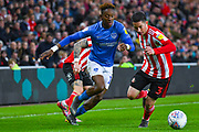 Jamal Lowe of Portsmouth (10) and Bryan Oviedo of Sunderland (3) in action during the EFL Sky Bet League 1 first leg Play Off match between Sunderland and Portsmouth at the Stadium Of Light, Sunderland, England on 11 May 2019.