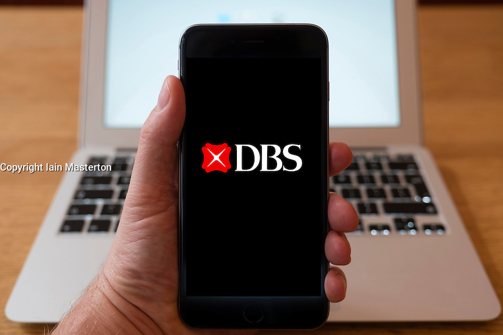 Using iPhone smart phone to display website logo of DBS, a Singaporean multinational banking and financial group