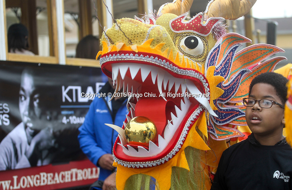 A young dragon dancer in the Martin Luther King Jr. parade in Los Angeles on Monday Jan. 18, 2016. The 31st annual Kingdom Day Parade honoring Martin Luther King Jr. was themed &quot;Our Work Is Not Yet Done&quot;(Photo by Ringo Chiu/PHOTOFORMULA.com)<br /> <br /> Usage Notes: This content is intended for editorial use only. For other uses, additional clearances may be required.