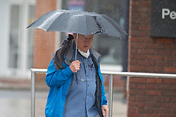 ©Licensed to London News Pictures 17/06/2020<br /> Bromley, UK. Umbrellas up for shoppers in Bromley high Street, Bromley, South East London. Torrential rain and thunderstorms across large parts of the UK today as the sunny weather takes a break. Photo credit: Grant Falvey/LNP