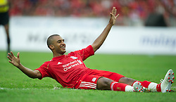 KUALA LUMPUR, MALAYSIA - Saturday, July 16, 2011: Liverpool's David Ngog celebrates scoring the first of his two goals against a Malaysia XI at the National Stadium Bukit Jalil in Kuala Lumpur on day six of the club's Asia Tour. (Photo by David Rawcliffe/Propaganda)