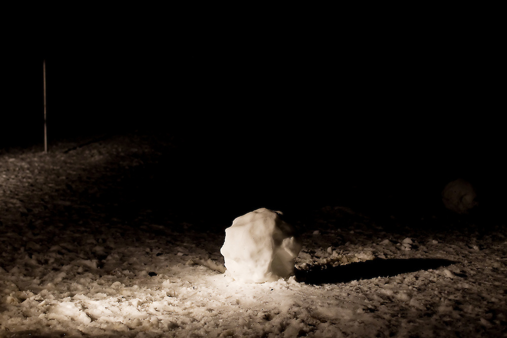 The lone base of a incomplete snowman is illuminated by a light from a classroom at Bryan Elementary in Coeur d'Alene.