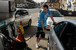 © Licensed to London News Pictures. 29/03/2012. Orpington, UK. A man filling a car with petrol at a petrol station in Orpington, South London on March 29, 2012. Photo credit : Grant Falvey/LNP