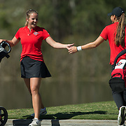 28 March 2018: Mila Chaves and Sara Kjellker high five as they pass each other on the sixteenth tee box during the final round of match play against UCLA at it's annual March Mayhem Tournament at the Farms Golf Club in Rancho Santa Fe, California.<br /> More game action at sdsuaztecphotos.com