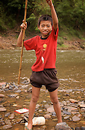 A large part of Laos people's livelihood comes from the rivers. They use them for trade, transportation, and of course fishing. Unfortunately, this has led to a huge decline in the fish population in recent years.....This boy isn't holding the bait. That's the fish he was trying to catch!