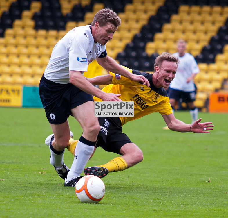 Iain Russell bounces off Darren Dods as he challenge's for the ball, Livingston v Falkirk, SFL Division 1