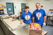 Roger Silveira, Maintenance and Operation Supervisor for <br /> Transportation and Safety works with Russell Middle School's Satellite Kitchen Operator Laura Cisneros pose for a photo during the California School Employees Association Appreciating Classified Employees event throughout the Milpitas Unified School District in Milpitas, California, on May 21, 2015. (Stan Olszewski/SOSKIphoto)