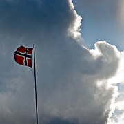 Three weeks aboard the Kong Harald. Hurtigruten, the Coastal Express. Bergen. The norwegian flag in Bergen.