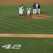 Mariano Rivera, the New York Yankees closer, sobs as he is removed from the game by Andy Pettitte and Derek Jeter during his final game at Yankee Stadium before his retirement during the New York Yankees V Tampa Bay Rays, American League baseball game at Yankee Stadium. Mariano Rivera is the last Major League player still wearing Jackie Robinson's No. 42. and holds the record for the number of saves in Major League Baseball. Yankee Stadium, The Bronx, New York USA. 26th September 2013. Photo Tim Clayton