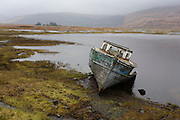 Beached fishing boat on shore at Pennyghael, Isle of Mull, Scotland.
