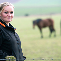 Janine Mason pictured at her farm near Coupar Angus in Perthshire, with 'Anja' and 'Bia' two of the horses she has rescued from a horse rescue charity in Portugal...19.03.15<br /> Picture by Graeme Hart.<br /> Copyright Perthshire Picture Agency<br /> Tel: 01738 623350  Mobile: 07990 594431