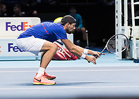 Tennis - 2017 Nitto ATP Finals at The O2 - Day Two<br /> <br /> Mens Doubles: Group Woodbridge/Woodforde: Lukasz Kubot (Poland) & Marcelo Melo (Brazil) Vs Ivan Dodig (Croatia) & Marcel Granollers (Spain)<br /> <br /> Lukasz Kubot (Poland) gets down low as his partner serves at the O2 Arena<br /> <br /> COLORSPORT/DANIEL BEARHAM