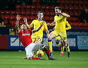Charlton Athletic midfielder Jordan Cousins getting fouled by Leeds United midfielder Lewis Cook during the Sky Bet Championship match between Charlton Athletic and Leeds United at The Valley, London, England on 12 December 2015. Photo by Matthew Redman.