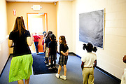 First graders make their way down a hallway to read outside with teacher Katie King at Kennesaw Charter School in Kennesaw, Georgia, April 1, 2010. The 440 student school, which used to be managed by Imagine Schools, is now self-managed.