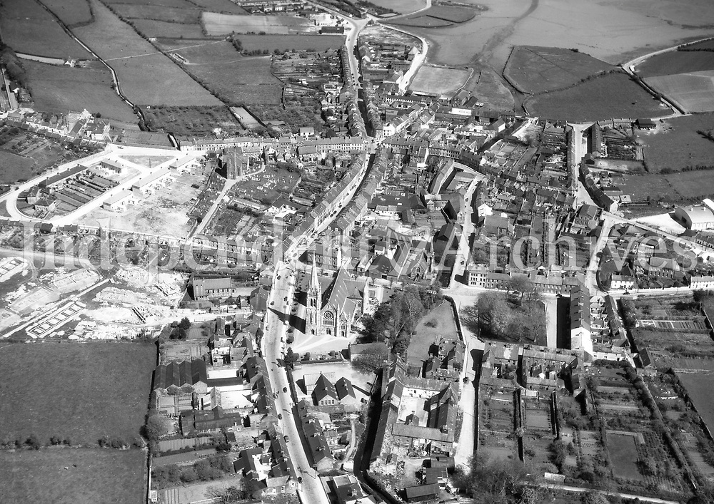 A117 Clonakilty.   06/02/53. (Part of the Independent Newspapers Ireland/NLI collection.)<br /> <br /> <br /> These aerial views of Ireland from the Morgan Collection were taken during the mid-1950's, comprising medium and low altitude black-and-white birds-eye views of places and events, many of which were commissioned by clients. From 1951 to 1958 a different aerial picture was published each Friday in the Irish Independent in a series called, 'Views from the Air'.<br /> The photographer was Alexander 'Monkey' Campbell Morgan (1919-1958). Born in London and part of the Royal Artillery Air Corps, on leaving the army he started Aerophotos in Ireland. He was killed when, on business, his plane crashed flying from Shannon.