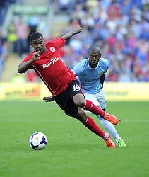 Cardiff City's Fraizer Campbell gets the better of Manchester City's Fernandinho  - Photo mandatory by-line: Joe Meredith/JMP - Tel: Mobile: 07966 386802 25/08/2013 - SPORT - FOOTBALL - Cardiff City Stadium - Cardiff -  Cardiff City V Manchester City - Barclays Premier League