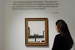 "© Licensed to London News Pictures. 31/03/2017. London, UK. A staff member views ""The Lookers On"", 1965, by LS Lowry (Est. GBP 50-80k).   Press preview of ""Made in Britain"" at Sotheby's in New Bond Street.  The auction on 5 April celebrates innovative British art in the twentieth century as well as artwork by political cartoonist Gerald Scarfe. Photo credit : Stephen Chung/LNP"