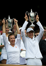LONDON, ENGLAND - Saturday, July 2, 2011: Kveta Peschke (CZE) L Katarina Srebotnik (SLO) R celebrate with the trophies after winning the Ladies' Doubles Final match on day twelve of the Wimbledon Lawn Tennis Championships at the All England Lawn Tennis and Croquet Club. (Pic by David Rawcliffe/Propaganda)