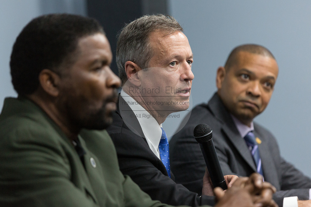 Former Maryland Governor and Democratic presidential candidate Martin O'Malley (center) during a discussion on gun violence with South Carolina Rep. Wendell Gilliard (left) and State Senator Marlon Kimpson at Mt. Moriah Baptist Church October 22, 2015 in North Charleston, South Carolina.