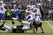 Oakland Raiders defensive end Khalil Mack (52) forces a fumble on a sack against Buffalo Bills quarterback Tyrod Taylor (5) in the fourth quarter at Oakland Coliseum in Oakland, Calif., on December 4, 2016. (Stan Olszewski/Special to S.F. Examiner)