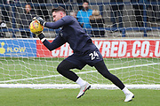 AFC Wimbledon goalkeeper Joe McDonnell (24) warming up during the EFL Sky Bet League 1 match between AFC Wimbledon and Southend United at the Cherry Red Records Stadium, Kingston, England on 24 November 2018.