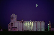 Rice: rice silo at night with half moon near Yuba City, California, USA.