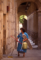 cleaning woman in Segovia, Spain - Photograph by Owen Franken