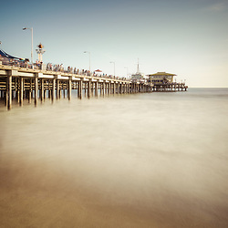 Santa Monica Pier retro photo. Santa Monica is a coastal beach city along the Pacific Ocean in Los Angeles County California. Photo is high resolution. Copyright ⓒ 2017 Paul Velgos with All Rights Reserved.