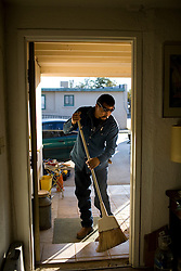 Employees of the Community Action Agency of Southern New Mexico(CAASNM) work on weatherizing a home.  The CAASNM received stimulus funding and, among other things, works on weatherizing the homes of poor families and individuals in New Mexico.