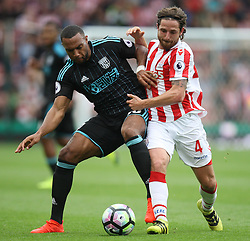 Matt Phillips of West Bromwich Albion (L) and Joe Allen of Stoke City in action - Mandatory by-line: Jack Phillips/JMP - 24/09/2016 - FOOTBALL - Bet365 Stadium - Stoke-on-Trent, England - Stoke City v West Bromwich Albion - Premier League
