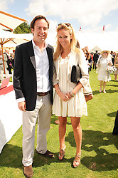 JAMIE MURRAY WELLS and EVEIE LONGDON at the Cartier International Polo at Guards Polo Club, Windsor Great Park, Berkshire on 25th July 2010.