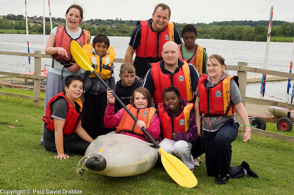 Adam Bates (centre) Guinness Northern Counties Youth Coordinator, and Phil Roache (back) Guinnesss Northern Counties Housing Officer with Kids from the Briary Close housing scheme in Wakefield Kayaking Pugneys Country Park on Thursday  26 August 2010 .Images © Paul David Drabble..