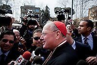 ROME, ITALY - MARCH 10: U.S. Cardinal Timothy Dolan of New York City speaks to the media before entering the Our Lady of Guadalupe church in the Monte Mario district, where he is the titular head, to give a Sunday Mass, in Rome, Italy, on March 10, 2013. Cardinals are set to enter the conclave to elect a successor to Pope Benedict XVI after he became the first pope in 600 years to resign from the role. The conclave is scheduled to start on March 12 inside the Sistine Chapel and will be attended by 115 cardinals as they vote to select the 266th Pope of the Catholic Church...Gianni Cipriano for The New York Times