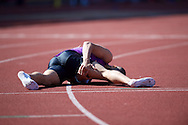 Adam Gemili GBR clutches his hamstring after competing in the 100m during the IAAF  Diamond League Sainsbury's Birmingham Grand Prix at Alexander Stadium, Birmingham<br /> Picture by Alan Stanford/Focus Images Ltd +44 7915 056117<br /> 07/06/2015
