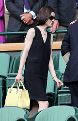 Image ©Licensed to i-Images Picture Agency. 26/06/2014. London, United Kingdom. Michelle Dockery leaving  the Royal Box on day four of the Wimbledon Tennis Championships. Picture by Stephen Lock / i-Images