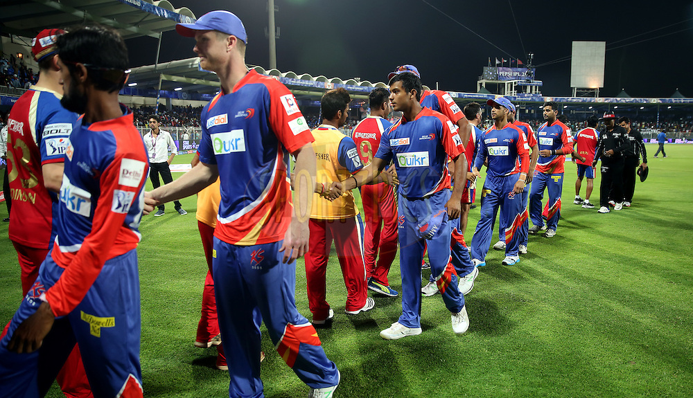 Teams Shakes hand after the match 2 of the Pepsi Indian Premier League Season 7 between the Delhi Daredevils and The Royal Challengers Bangalore held at the Sharjah Cricket Stadium, Sharjah, United Arab Emirates on the 17th April 2014<br /> <br /> Photo by Sandeep Shetty / IPL / SPORTZPICS