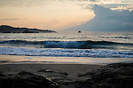 Sunrise coastal scene at the Pacific Ocean in Mazunte, Oaxaca State, Mexcio.