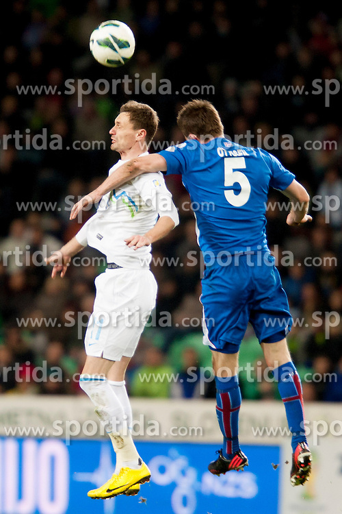 Milivoje Novakovic #11 of Slovenia and Solvi Ittesen Jonsson #5 of Iceland during football match between National teams of Slovenia and Iceland in Group E of FIFA World Cup 2014 Qualification on March 22, 2013 in SRC Stozice, Ljubljana, Slovenia. (Photo By Urban Urbanc / Sportida).