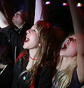 Girls in crowd cheering and dancing to band, Masonic Place, Nottingham.