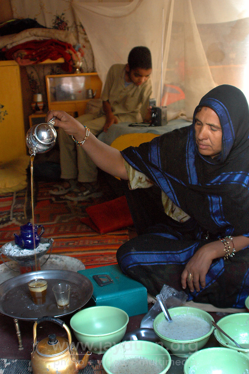 Niger,Agadez,2007. In the time-honored Tuareg fashion, tea is made strong and sweet by Takita Ixa, inside her room at  Mohammad Ixa's family home. .