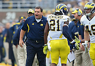 November 05, 2011: Michigan Wolverines head coach Brady Hoke greets Michigan Wolverines wide receiver Junior Hemingway (21) after a touchdown drive during the first quarter of the NCAA football game between the Michigan Wolverines and the Iowa Hawkeyes at Kinnick Stadium in Iowa City, Iowa on Saturday, November 5, 2011. Iowa defeated Michigan 24-16.