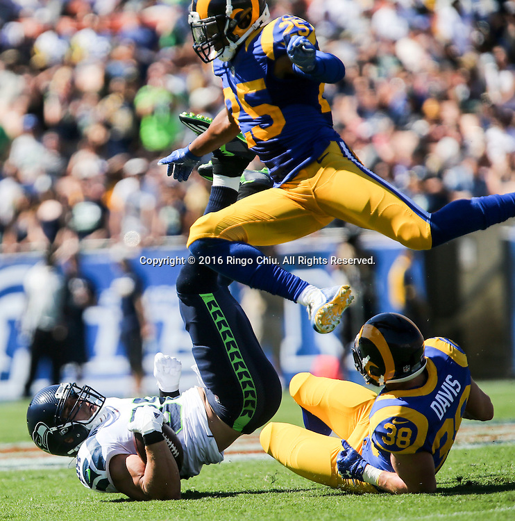 Los Angeles Rams strong safety T.J. McDonald (25) leaps over his teammate strong safety Cody Davis(38) and  Seattle Seahawks tight end Jimmy Graham (88) during a NFL football game, Sunday, Sept. 18, 2016, in Los Angeles. The Rams won 9-3. (Photo by Ringo Chiu/PHOTOFORMULA.com)<br /> <br /> Usage Notes: This content is intended for editorial use only. For other uses, additional clearances may be required.